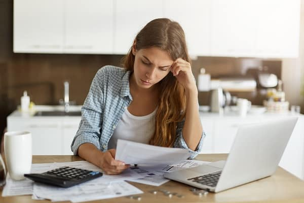 A woman, distressed over her bills considers Chapter 13 Bankruptcy