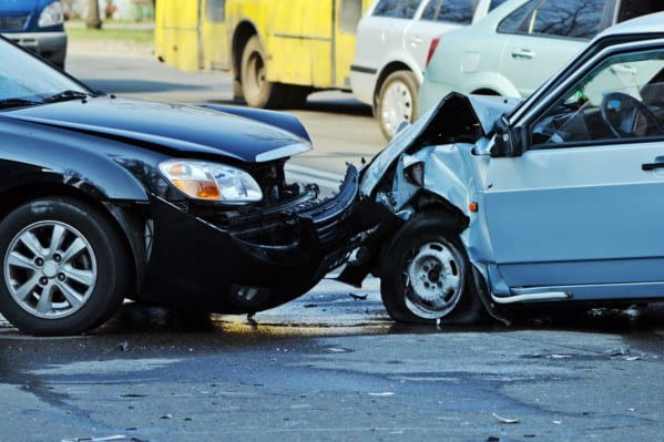 The crushed front bumpers of two cars after an accident