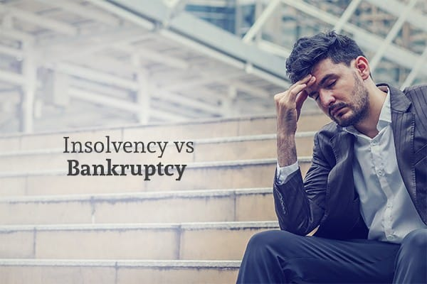 "A man sits on the stairs looking stressed and defeated beside the words ""Insolvency vs Bankruptcy"""