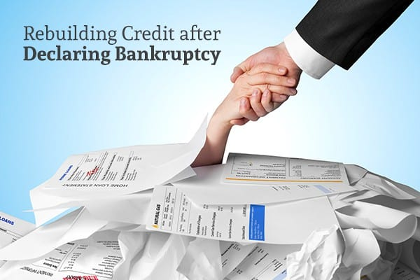 A person under a pile of bills reaching their hand up and someone reaching their hand down to help pull them out of it beside the words rebuilding credit after declaring bankruptcy